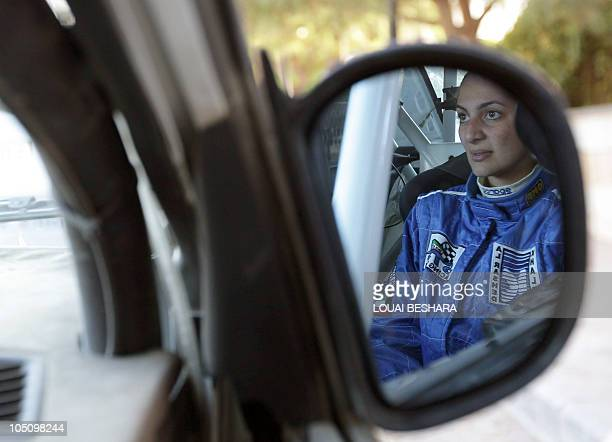 Dana Assaf Lebanese codriver to Kwuait's Mezher alTnak is seen in the wing mirror of their vehicle at the finish line of the 10th Syrian...