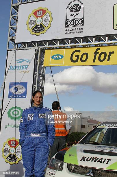 Dana Assaf Lebanese codriver to Kwuait's Mezher alTnak poses at the finish line of the 10th Syrian International Rally round six of the FIA Middle...