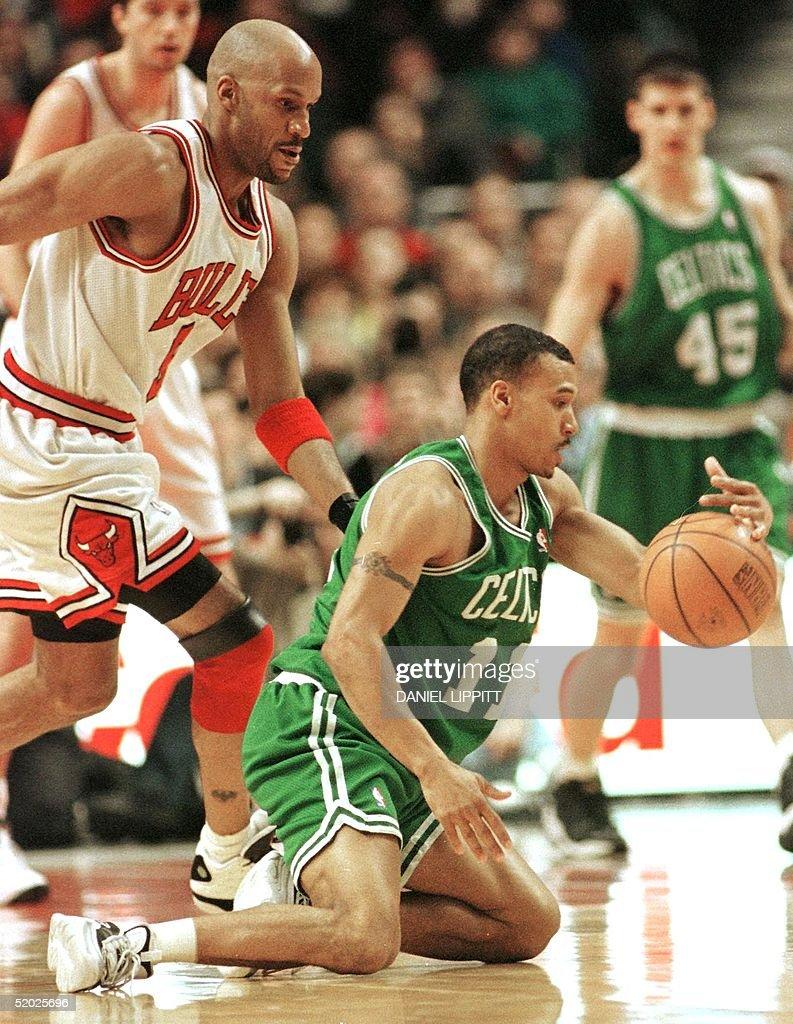 Dana Barros of the Boston Celtics R loses contro