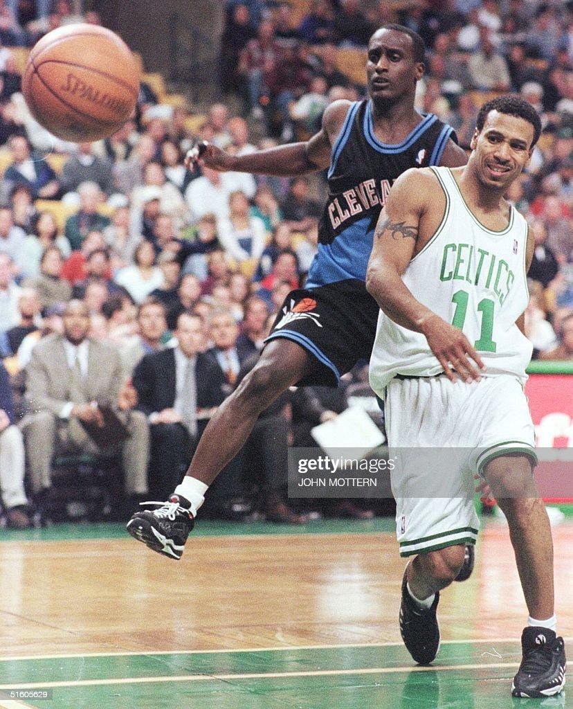 Dana Barros 11 of the Boston Celtics passes the