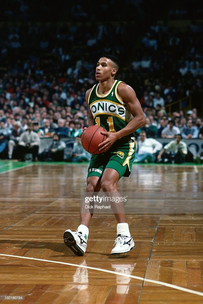 Dana Barros #11 of the Seattle Supersonics looks to make a play against the Boston Celtics during a game played in 1990 at the Boston Garden in Boston, Massachusetts.