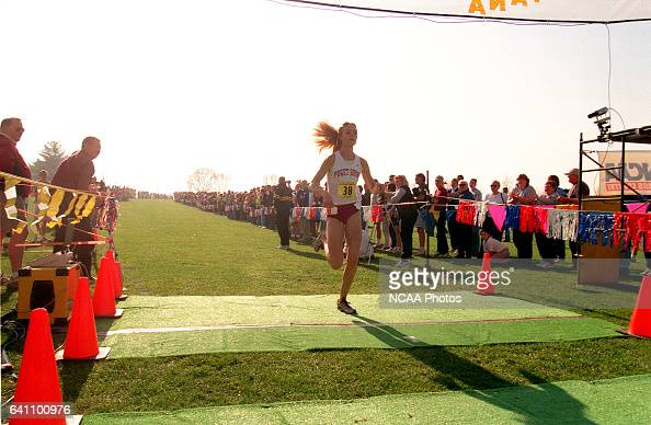 Dana Boyle of the Univ of Puget Sound crosses the finish line to win the Women's Division 3 Cross Country Championship hosted by Augustana College...