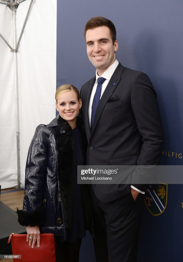 Dana Flacco and NFL player Joe Flacco pose backstage at the Tommy Hilfiger Men's Fall 2013 fashion show during Mercedes-Benz Fashion Week at Park Avenue Armory on February 8, 2013 in New York City.