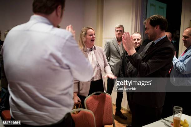 Dana Guth top candidate of Germany's far right AfD party celebrates with supporters following initial results that give the AfD a finish with 62% of...