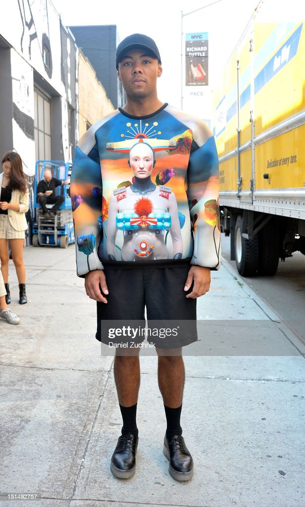 Dana Mason seen outside the General Idea show wearing a Jung Jae sweatshirt, Ralph Lauren shorts, Calvin Klein Collection shoes and a New Era hat on September 7, 2012 in New York City.