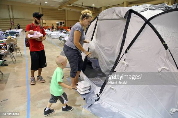 Dana Swally heads into a privacy tent with her son Landon fivedayold baby Alayna and her partner Ken at the E Darwin Fuchs Pavilion at the MiamiDade...