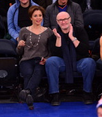 Dana Tyler and Phil Collins attend the Cleveland Cavaliers vs New York Knicks game at Madison Square Garden on January 30 2014 in New York City