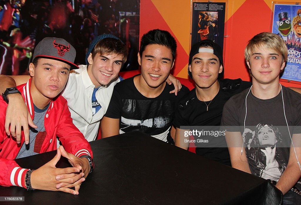Dana Vaughns Cole Pendery Will Jay Gabe Morales and Dalton Rapattoni of the group IM5 visit Planet Hollywood Times Square on July 29 2013 in New York...