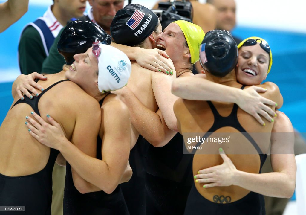 Dana Vollmer of the United States, Alicia Coutts of Australia, Missy Franklin of the United States, Leisel Jones of Australia, Allison Schmitt of the United States and Emily Seebohm of Australia congratulate each other following the Women's 4x100m Medley Relay on Day 8 of the London 2012 Olympic Games at the Aquatics Centre on August 4, 2012 in London, England.
