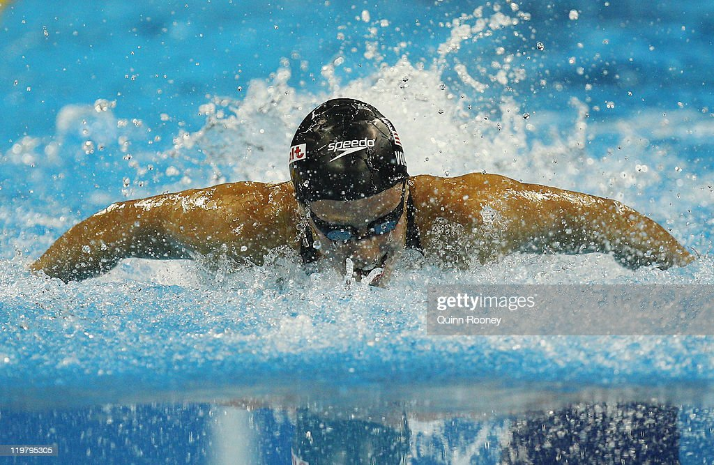 <a gi-track='captionPersonalityLinkClicked' href=/galleries/search?phrase=Dana+Vollmer&family=editorial&specificpeople=240582 ng-click='$event.stopPropagation()'>Dana Vollmer</a> of the United States swims her way to winning the gold medal in the Women's 100m Butterfly final during Day Ten of the 14th FINA World Championships at the Oriental Sports Center on July 25, 2011 in Shanghai, China.