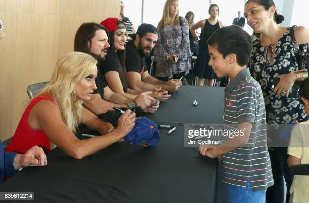 Dana Warrior Nikki Bella AJ Styles and Seth Rollins greet a wish kid at the WWE Superstars Surprise MakeAWish Families at One World Observatory on...