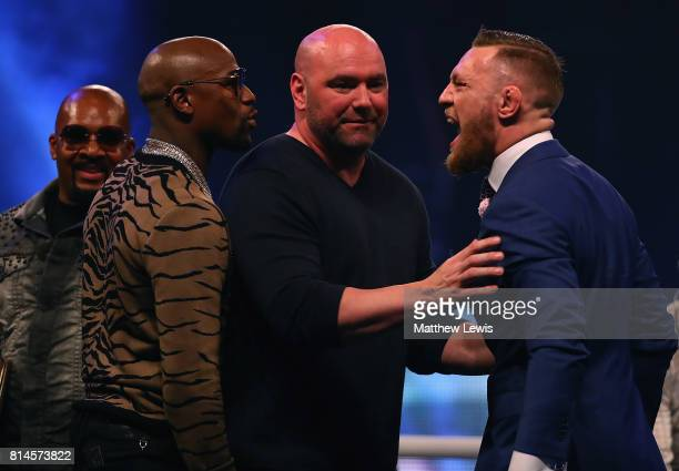 Dana White splits Floyd Mayweather Jr and Conor McGregor apart during the Floyd Mayweather Jr v Conor McGregor World Press Tour at SSE Arena on July...
