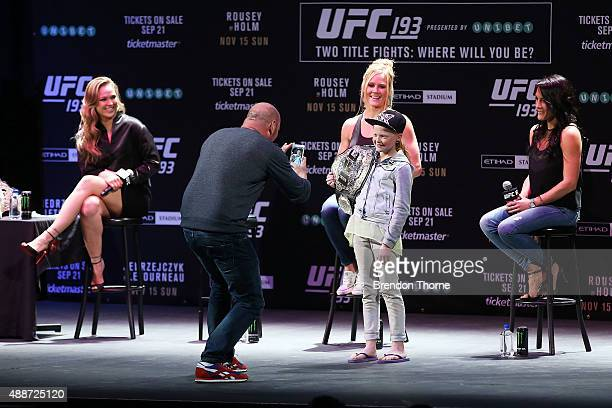 Dana White takes a photo of a young fan during a UFC 193 Sydney Fan Event on September 17 2015 in Sydney Australia