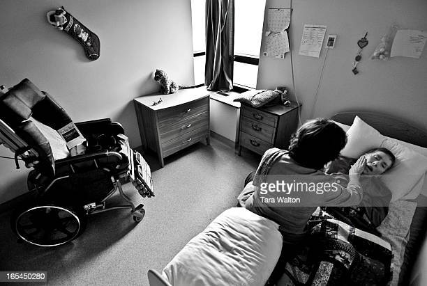 Danae Chambers lays in her bed at Castleview Wychwood Towers a Toronto longterm care home during a visit with long time friend and now her power of...