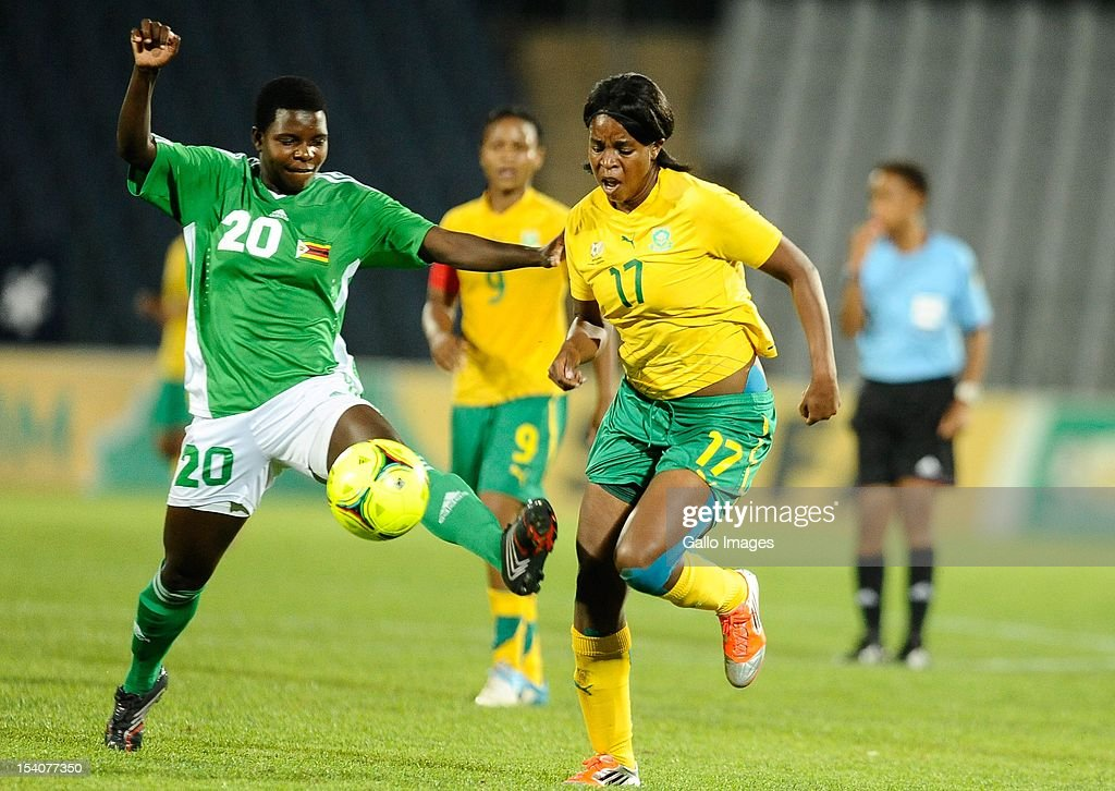Danai Bhobho of Zimbabwe and Andisiwe Mgcoyi (R) of South Africa compete for the ball during the Womens International Friendly match between South Africa and Zimbabwe at Volkswagen Dobsonville Stadium on October 13, 2012 in Dobsonville, South Africa.