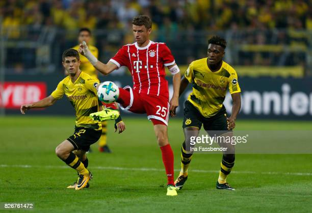 DanAxel Zagadou and Christian Pulisic of Dortmund challenge Thomas Mueller of Munich during the DFL Supercup 2017 match between Borussia Dortmund and...