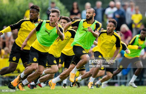 DanAxel Zagadou and Oemer Toprak of Borussia Dortmund in action during a training session as part of the training camp on July 27 2017 in Bad Ragaz...
