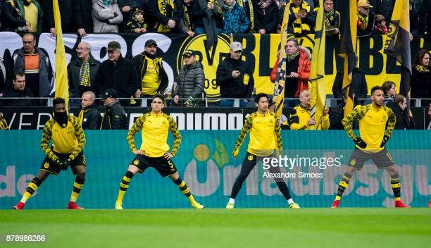 DanAxel Zagadou Marc Bartra Shinji Kagawa and PierreEmerick Aubameyang of Borussia Dortmund are warming up prior to the Bundesliga match between...