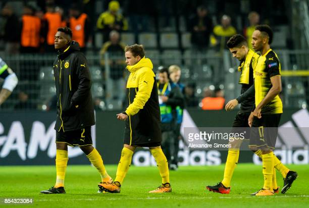 DanAxel Zagadou Mario Goetze Marc Bartra and PierreEmerick Aubameyang of Borussia Dortmund after the final whistle during the UEFA Champions League...