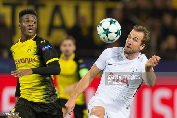 DanAxel Zagadou of Borussia Dortmund and Harry Kane of Tottenham Hotspur battle for the ball during the UEFA Champions League group H match between...