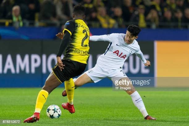 DanAxel Zagadou of Borussia Dortmund and HeungMin Son of Tottenham Hotspur battle for the ball during the UEFA Champions League group H match between...