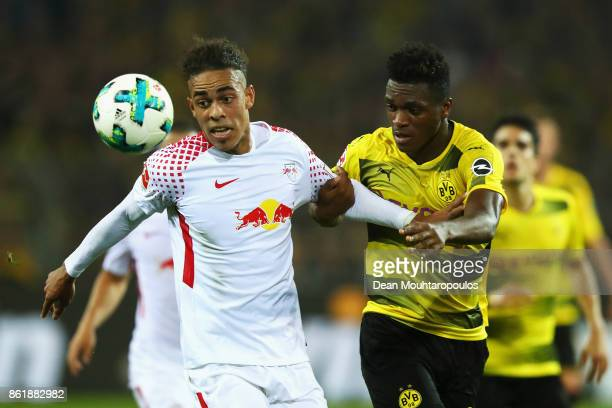 DanAxel Zagadou of Borussia Dortmund battles for the ball with Yussuf Poulsen of RB Leipzig during the Bundesliga match between Borussia Dortmund and...