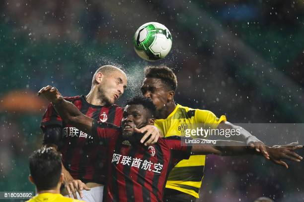 DanAxel Zagadou of Borussia Dortmund competes for the ball with Frank Kessie of AC Milan during the 2017 International Champions Cup football match...