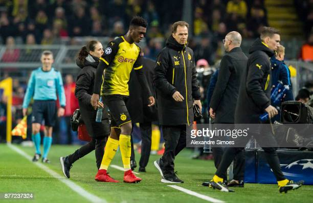 DanAxel Zagadou of Borussia Dortmund leaves the match after getting injured during the UEFA Champions League match between Borussia Dortmund and...