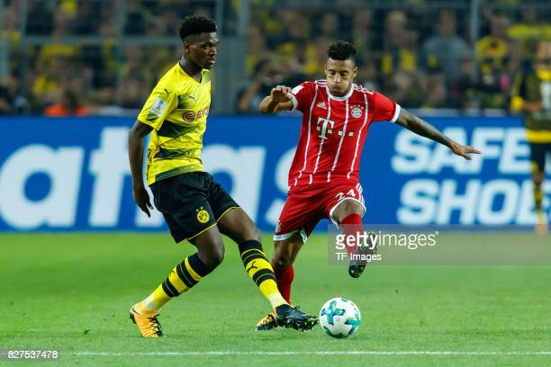 DanAxel Zagadou of Dortmund and Corentin Tolisso of Bayern Muenchen battle for the ball during the DFL Supercup 2017 match between Borussia Dortmund...