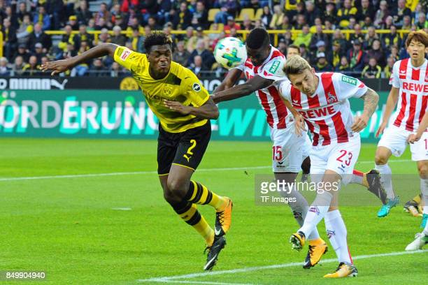 DanAxel Zagadou of Dortmund and Jannes Horn of Koeln battle for the ball during the Bundesliga match between Borussia Dortmund and 1 FC Koeln at the...