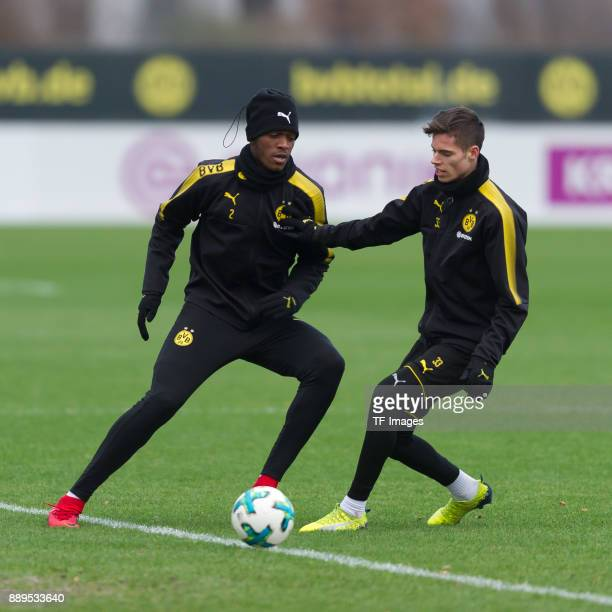 DanAxel Zagadou of Dortmund and Julian Weigl of Dortmund battle for the ball during a training session at BVB trainings center on December 7 2017 in...