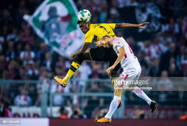 DanAxel Zagadou of Dortmund and Konrad Laimer of Leipzig head the ball during the Bundesliga match between Borussia Dortmund and RB Leipzig at Signal...