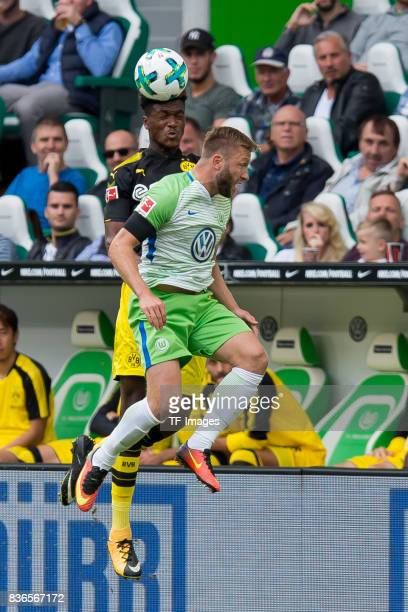 DanAxel Zagadou of Dortmund and Kuba Jakub Blaszczykowski of Wolfsburg battle for the ball during to the Bundesliga match between VfL Wolfsburg and...
