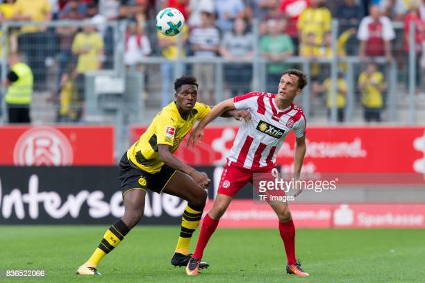 DanAxel Zagadou of Dortmund and Marcel Platzek of Essen battle for the ball during the preseason friendly match between RotWeiss Essen and Borussia...