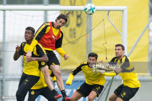 DanAxel Zagadou of Dortmund and Neven Subotic of Dortmund battle for the ball during a training session as part of the training camp on July 27 2017...