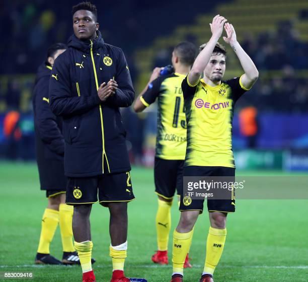 DanAxel Zagadou of Dortmund and Raphael Guerreiro of Dortmund gesture during the UEFA Champions League group H match between Borussia Dortmund and...
