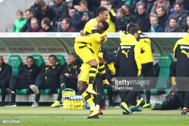 DanAxel Zagadou of Dortmund celebrates with PierreEmerick Aubameyang of Dortmund after he scored a goal to make it 11 during the Bundesliga match...