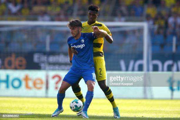 DanAxel Zagadou of Dortmund challenges Stefan Celozzi of Bochum during the preseason friendly match between VfL Bochum and Borussia Dortmund at...