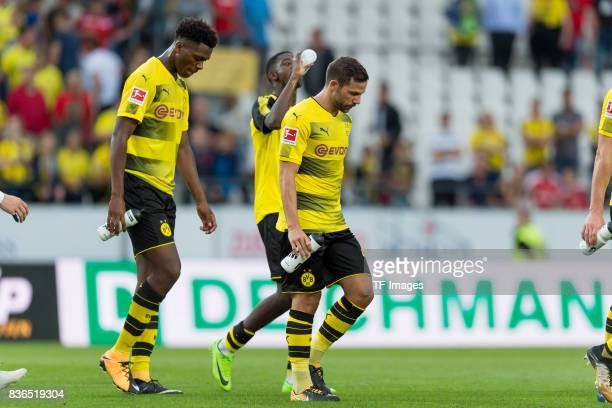 DanAxel Zagadou of Dortmund Gonzalo Castro of Dortmund and Ousmane Dembele of Dortmund looks dejected during the preseason friendly match between...