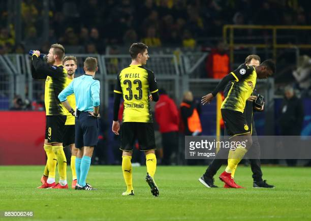 DanAxel Zagadou of Dortmund leaves the field injured during the UEFA Champions League group H match between Borussia Dortmund and Tottenham Hotspur...