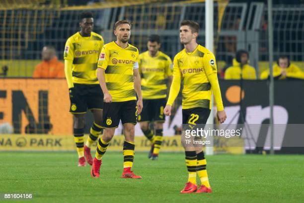 DanAxel Zagadou of Dortmund Marcel Schmelzer of Dortmund and Christian Pulisic of Dortmund looks dejected during the Bundesliga match between...