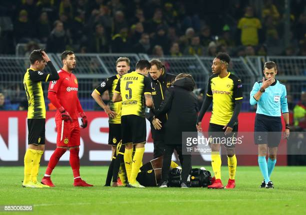 DanAxel Zagadou of Dortmund receives medical help from dr Markus Braun of Dortmund during the UEFA Champions League group H match between Borussia...