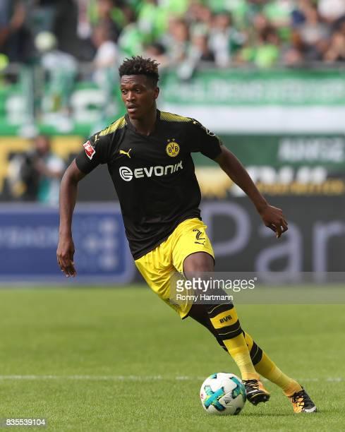DanAxel Zagadou of Dortmund runs with the ball during the Bundesliga match between VfL Wolfsburg and Borussia Dortmund at Volkswagen Arena on August...