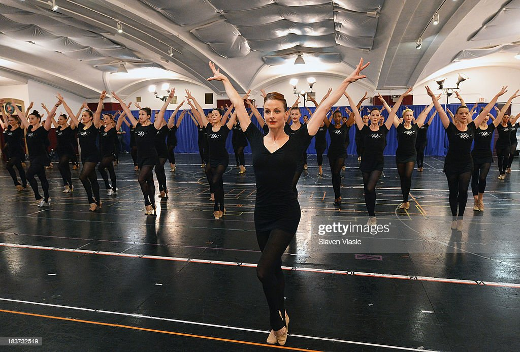 Dance captain Karen Keeler (C) and New York City Rockettes perform during the 2013 Radio City Christmas Spectacular Rehearsals Kick Off at St. Paul The Apostle Church on October 9, 2013 in New York City.