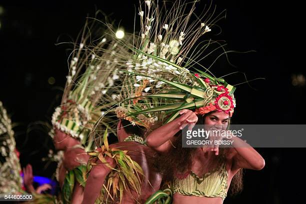 Dance company Hei Rurutu perform on July 2 2016 in Papeete during the Heiva I Tahiti a contest from June 30 to July 23 that brings together dozens of...
