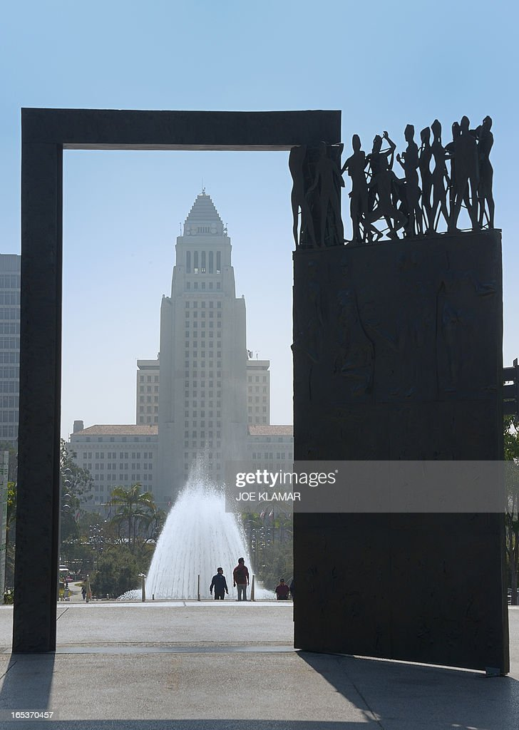 'Dance Door' in Los Angeles, California on April 03, 2013. 'Dance Door,' by artist Robert Graham, is installed in front of Los Angeles Music Center and it was gift of Frederic R Weisman. The Los Angeles City Hall is in the background.