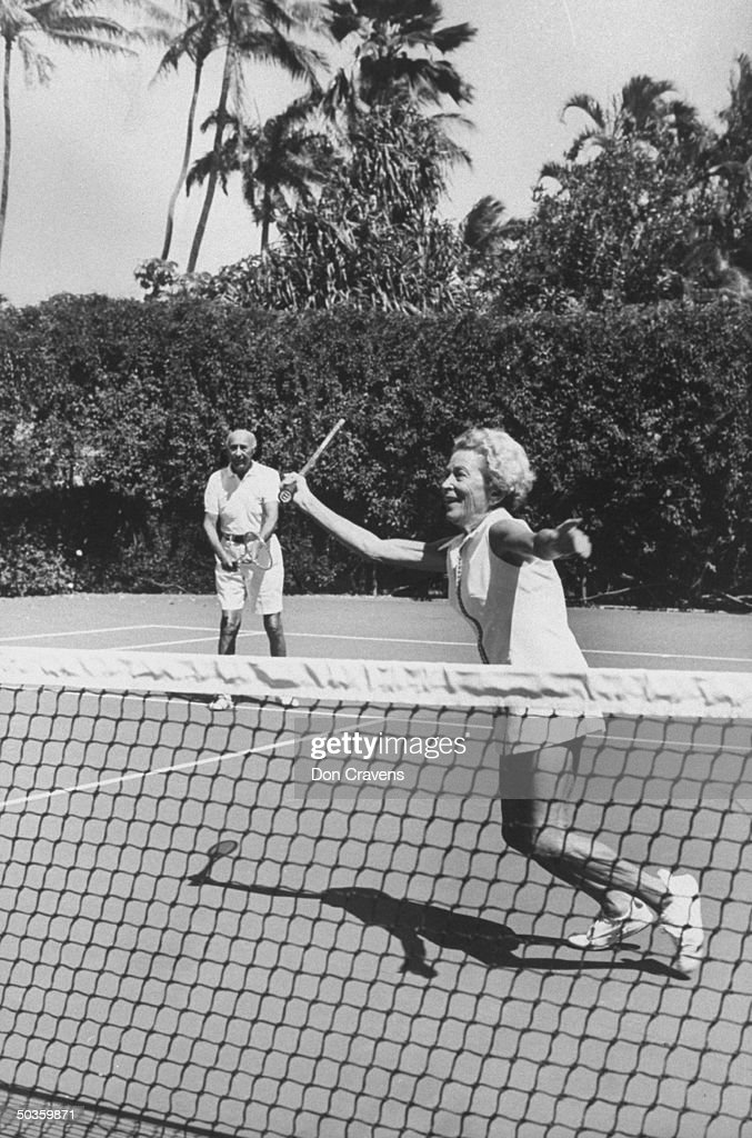 Dance expert Arthur Murray playing tennis with his wife.