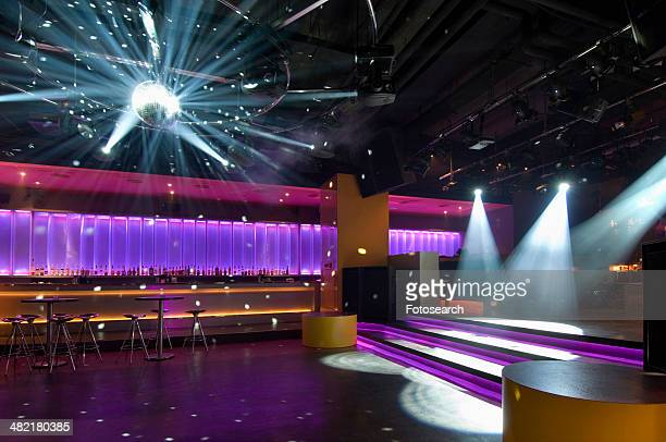 Dance floor with disco ball in modern nightclub