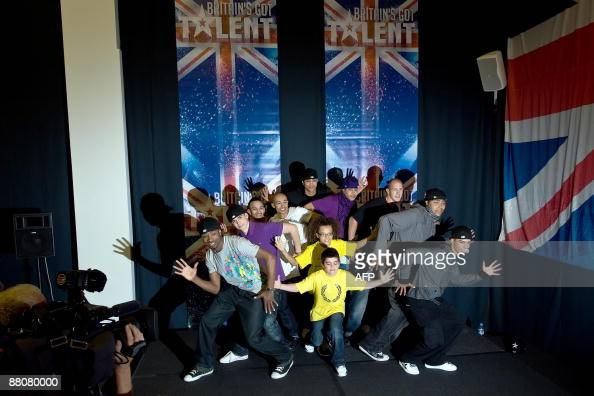Dance group 'Diversity' pose for photographers at a press conference in West London on May 31 following their victory in the final of television...