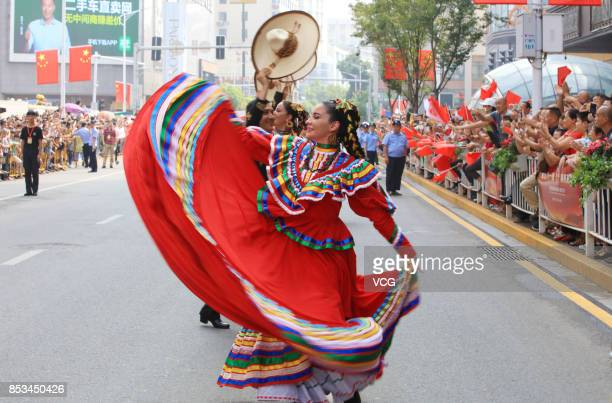 A dance group from Mexico perform during the opening parade of the 5th Nanchang International Military Tattoo on September 24 2017 in Nanchang...